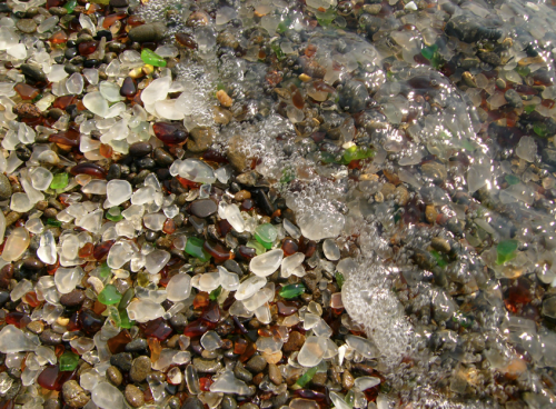 human left waste has transformed into something beautiful: sea glass on a beach in  California, nature has a way of helping itself